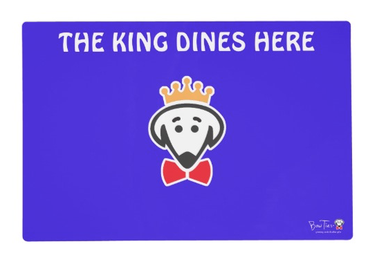 "Placemat: Side A- ""The King/Queen Dines Here"" Side B- ""Feed the King/Queen!"""